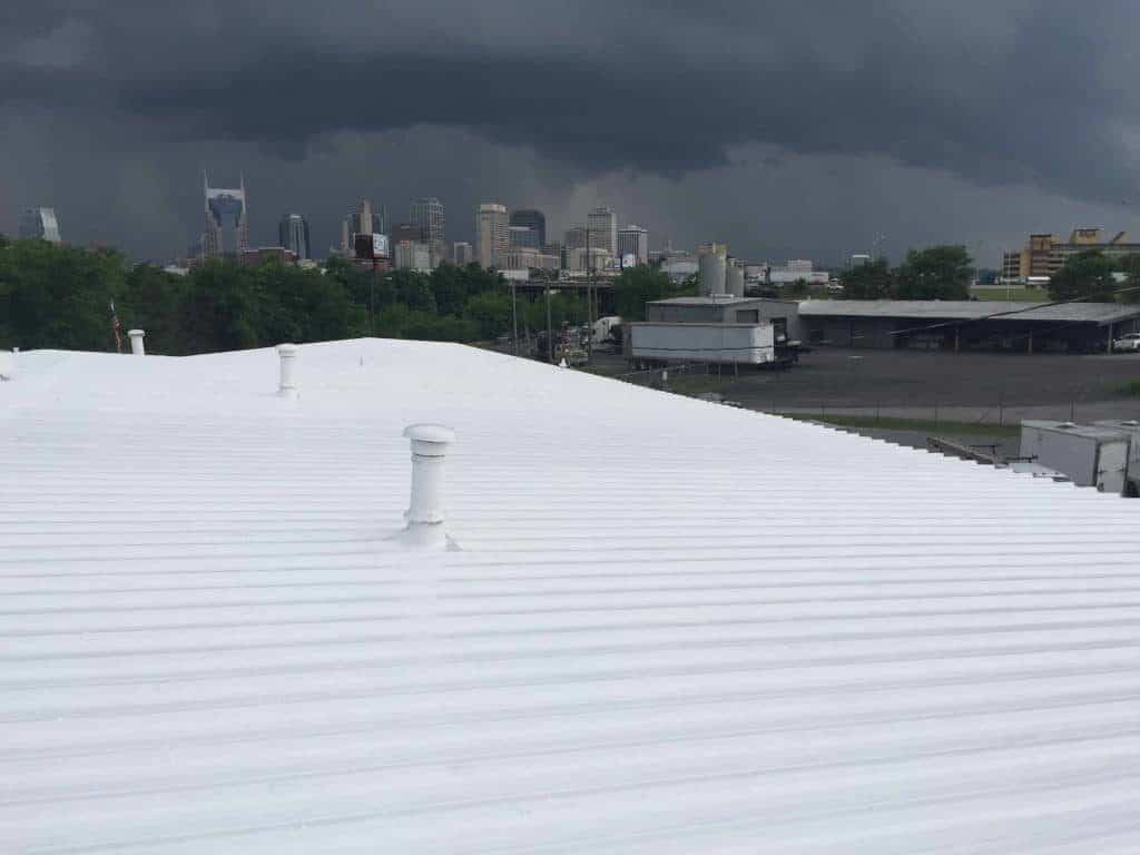 A GE High Solid Silicone roofing system in stormy Nashville.